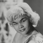 A young African American woman with short, blonde hair
