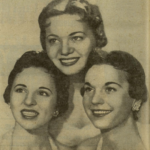Three young white women in a posed studio shot