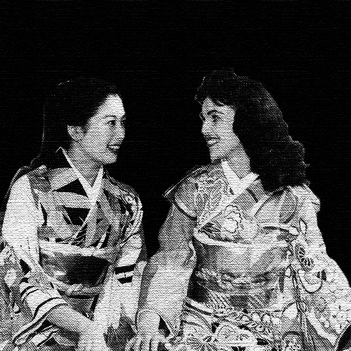 two women in kimonos, one white and one Asian.