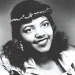 black and white photo of an african american woman with long, curly hair